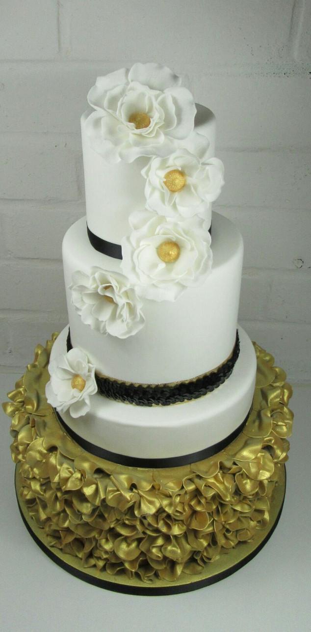 fondant-ruffle-wedding-cake-white-gold