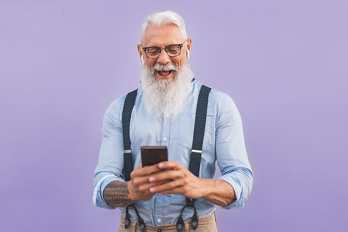 Senior man using mobile smartphone and l