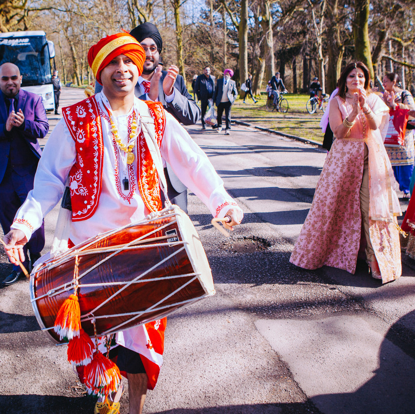 Dhol players in traditional outfits