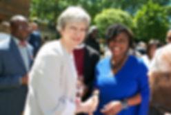Prime Minsiter Theresa May and Dr Shola