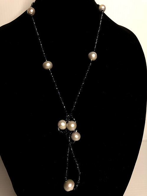 Black beads notted for a drop necklace with white FWP