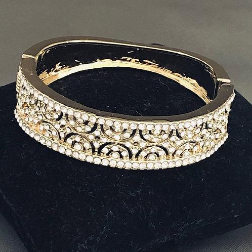 Designer look Gold hinged bracelet with Austrian crystals.