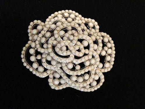 White enameled flower brooch