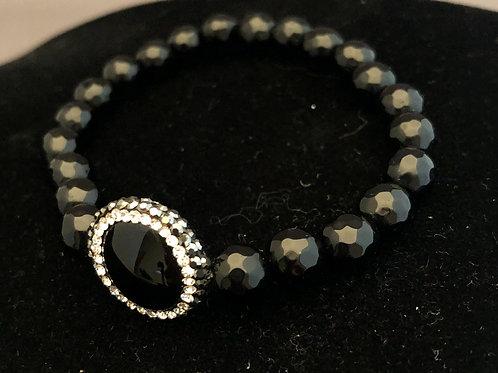 Black crystal elastic bracelet with large black onyx coin shaped