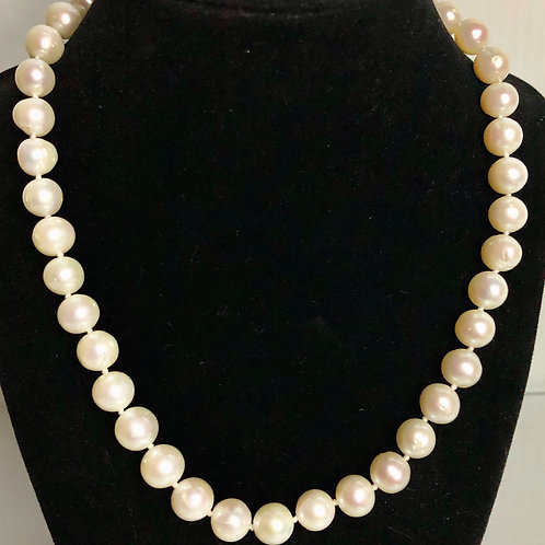 Single strand freshwater pearl necklace, bracelet with 14 kt gold clasp
