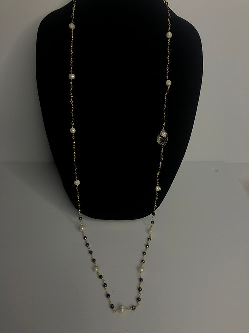 Long silver necklace with many different pieces and white FWP