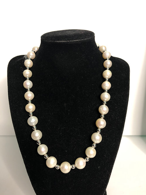 Single strand white Freshwater pearls set in sterling silver