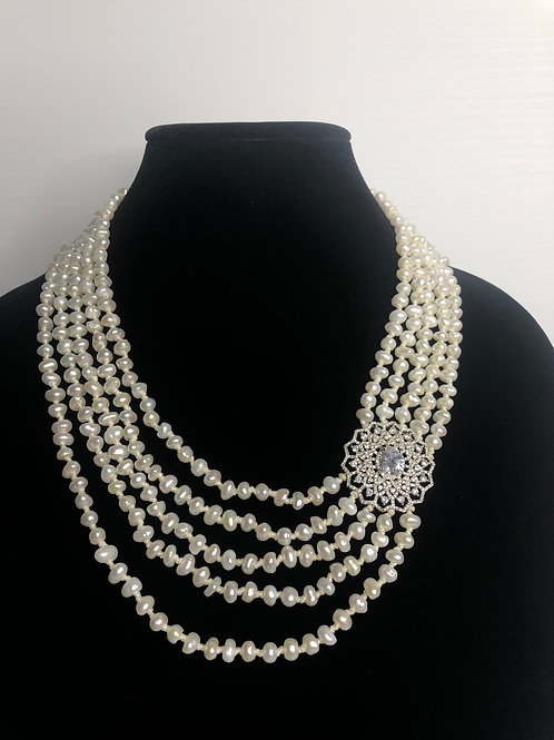 5 strand of white FWP necklace with beautiful sterling silver piece