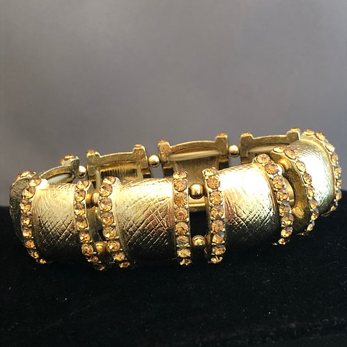 Gold elastic bracelet with champagne crystals