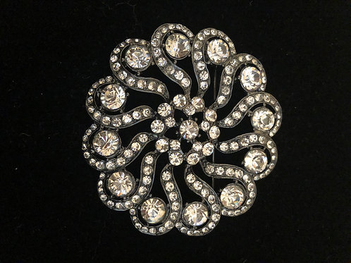 Black round with clear crystal brooch