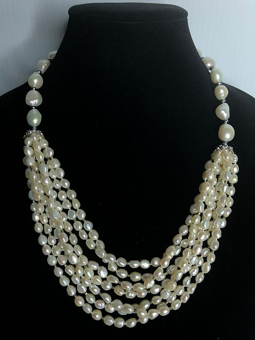 7 strands of FWP cascading from larger mm oval pearls