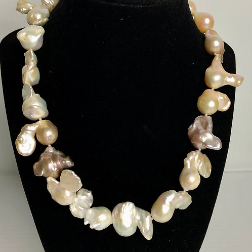 Large mm Baroque pinky/beige tone pearls all notted
