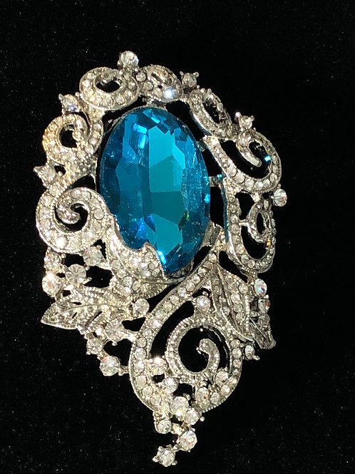 Large blue stone with clear crystals surrounding