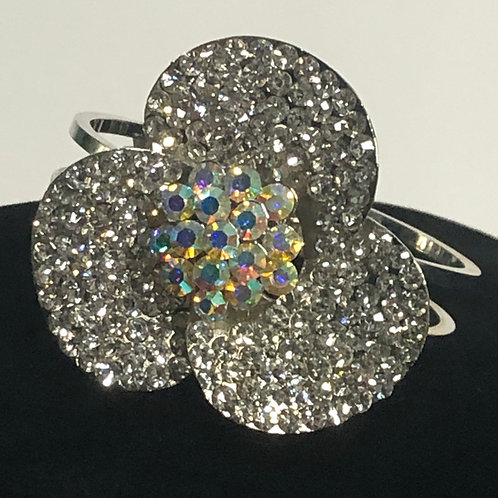 Silver flower hinged design in Aurora Borealis bracelet
