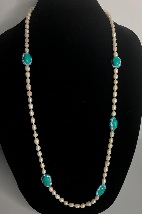 Long white Freshwater Cultured pearl necklace with oval  turquoise stones