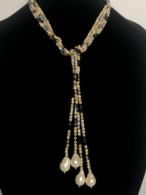 Multi strand fall like natural stones that tie into a beautiful piece with  larg