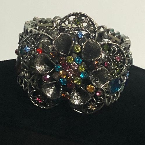 Multi color Austrian crystal flower in center elastic bracelet