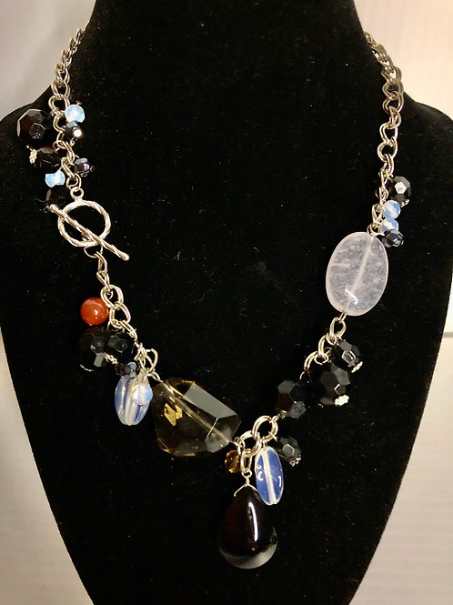 Silver chain necklace with several  varying gemstones dangling