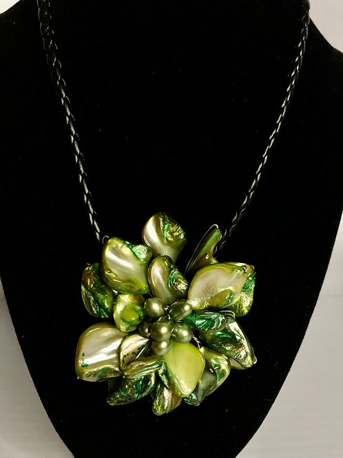 Flower shaped necklace made with shells and GREEN pearls
