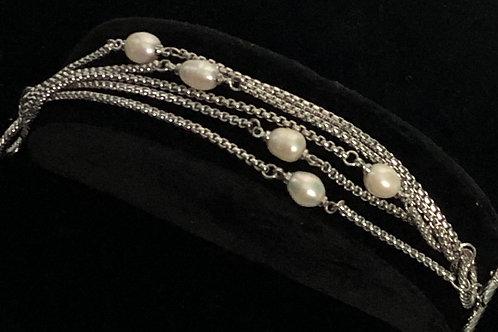 Multi strand bracelet with white Freshwater pearls