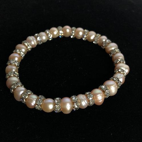 Single strand FWP bracelet with silver spindels
