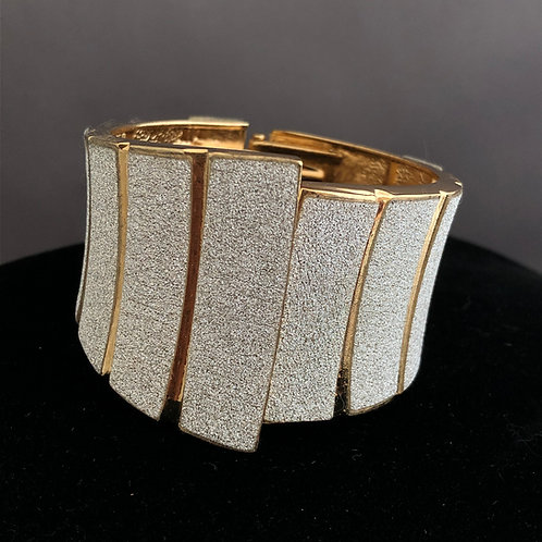 Crushed diamondtechnique in two tone hinged bracelet