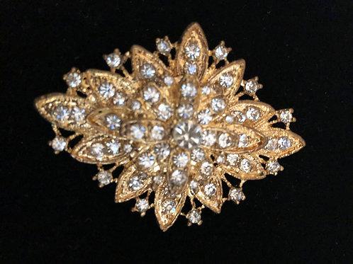 Gold dramatic crystal brooch