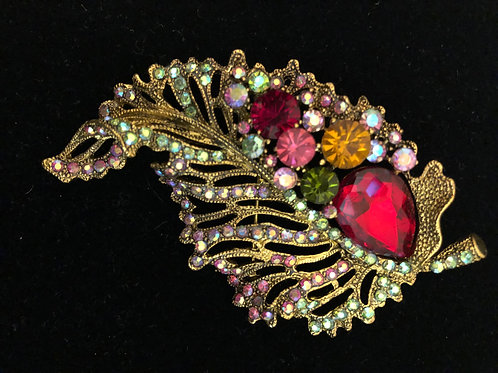 Gold leaf in multi colored crystal brooch