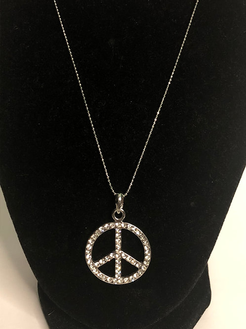 Peace sign with clear crystal pendant