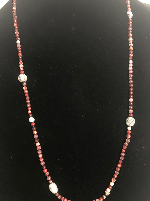 Red wood beaded necklace with sterling silver decorative beads