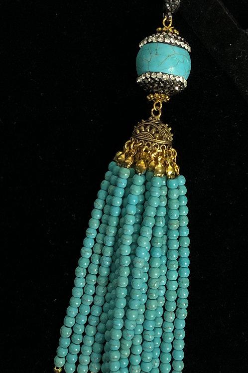 Turquoise tassel with black Austrian crystal enhancer