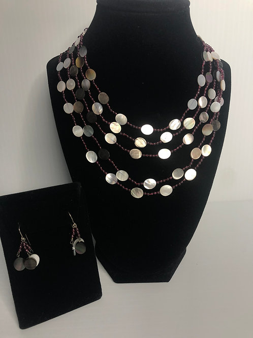 5 strands of Tahitian oval shells with garnet stones set