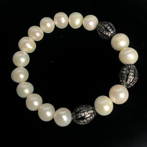 White FWP bracelet with Black decorative pieces