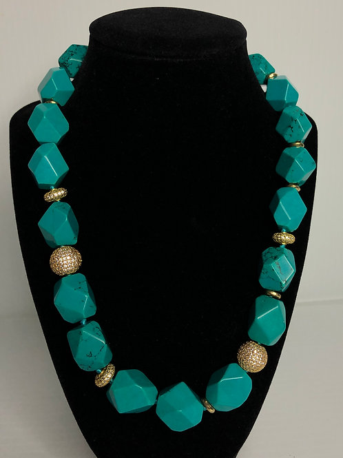 Turquoise stones with gold balls donned in  crystal necklace