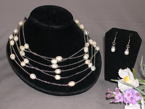 Multi layered silver set in Freshwater pearls