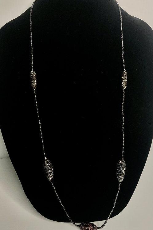 Long hematite necklace with long barreled black stones