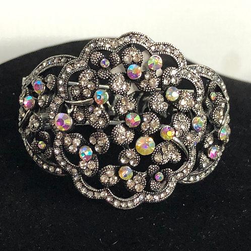 Aurora Borealis crystals in hinged bracelet