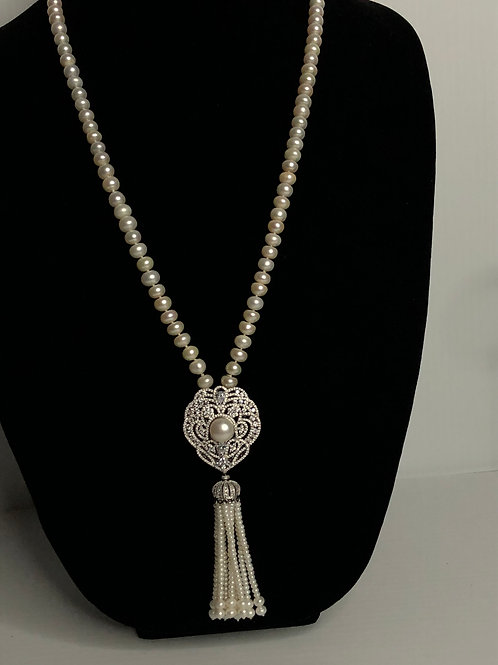White FWP tassel necklace with the most spectacular tassel