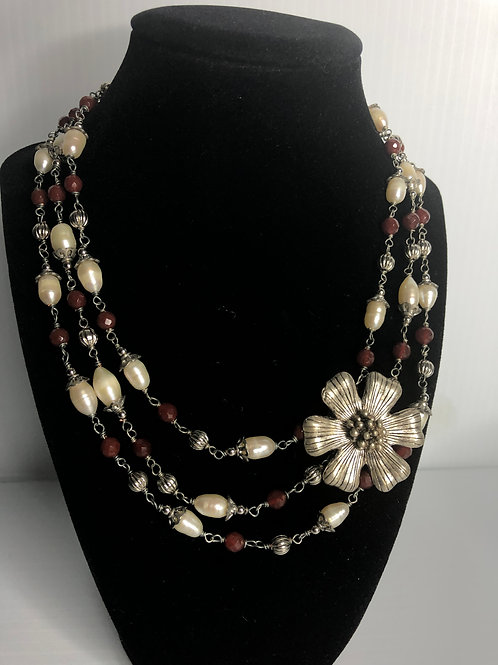 Triple strand Carnelian and pearl necklace with silver flower detail