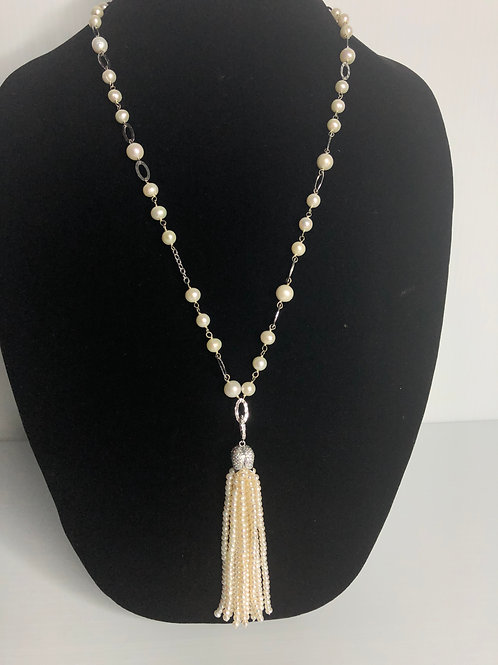 White FWP tassel necklace, all hand notted set in sterling