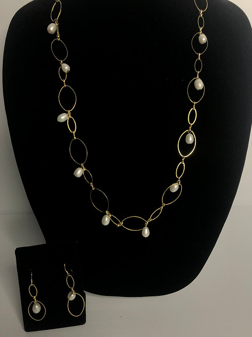 Long gold plated necklace with dangling white FWP set