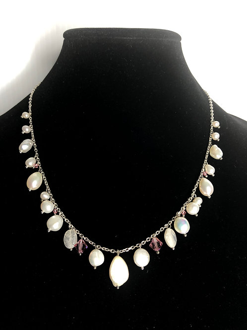 Single strand white FWP set in sterling silver with pearl