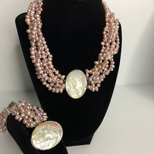 8 strands FWP in pink with a Cameo clasp in Mother of Pearl