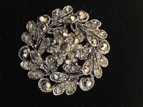 Black round Austrian crystal brooch