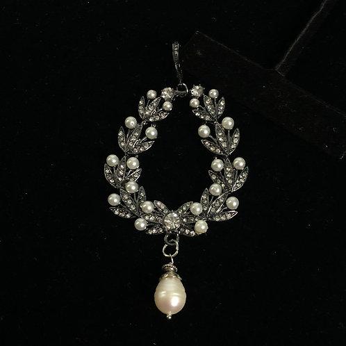 Tear drop design in black hematite with white pearl enhancer