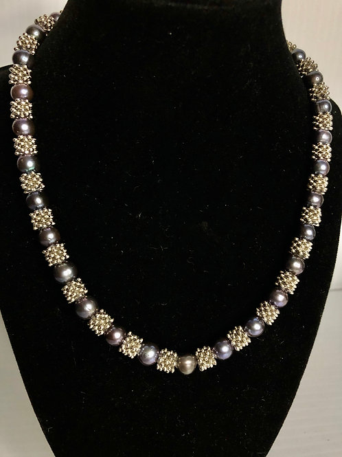 Black round Freshwater pearl necklace with silver spirals
