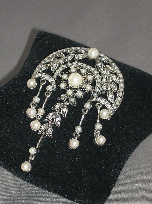 Half moon silver matted brooch with silver dangles in white pearls