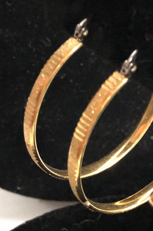 Thin diamond cut medium stainless steel in gold hoop earring