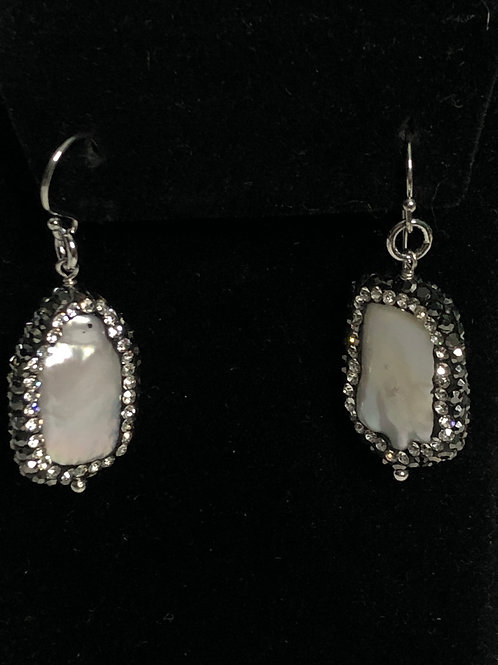 Sterling silver wire with rectangular shaped pearl earring surrounded with black