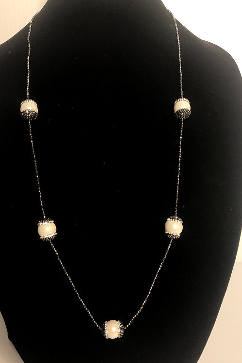 Long black hematite necklace with large white FWP baroque